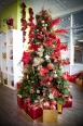 Red and green ornaments and floral sprays adorn this traditional tree. Prices start from $4.00 in the Gibbons Home Store